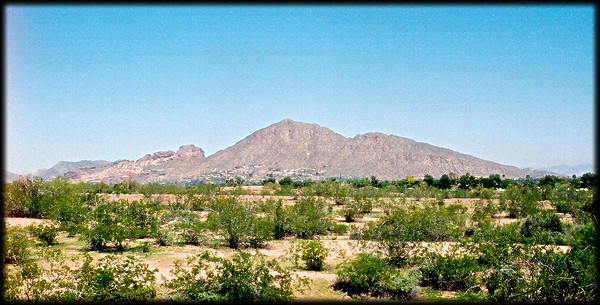 Camelback Mountain, one of the most recognizable Phoenix landmarks, as seen from Papago Park.  Sanctuary on Camelback, the Royal Palms Hotel, and the Phoenician are a