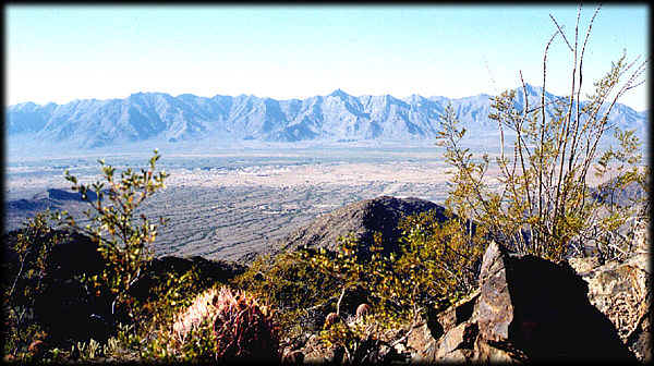 The Sierra Estrella stretch across this view from Alta Ridge in South Mountain Park and Preserve, Phoenix, Arizona.  The Gila River Valley is in the foreground.