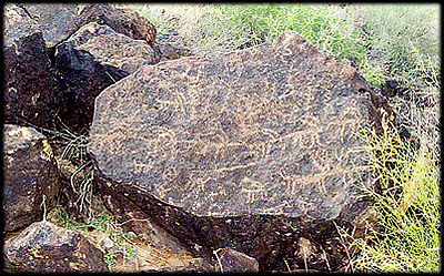 Ancient petroglyphs decorate a basalt boulder at the Deer Valley Rock Art Center in Phoenix, Arizona.