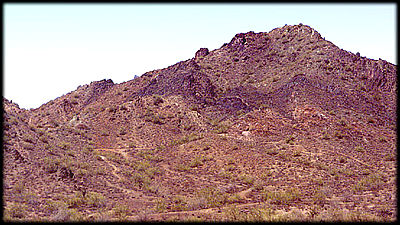 Ferruginous quartzite (the dark rocks) in Phoenix Mountains, Phoenix, Arizona.