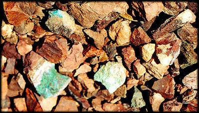 Bright blue pebbles catch the eye. Is it turquoise?