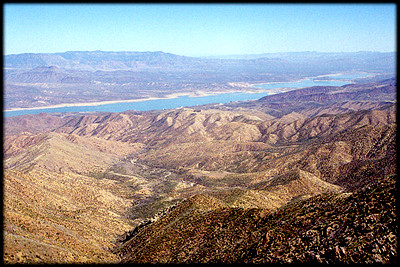 The Sierra Ancha, along the left skyline, appear deceptively gentle. Roosevelt Lake is in the foreground.