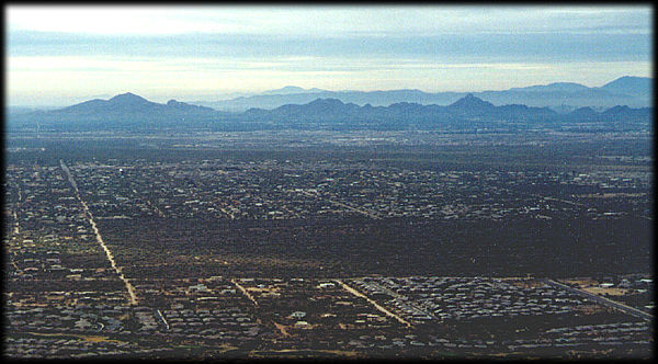 In the distance are the Phoenix Mountains, as seen from the top of Black Mountain, looking south over Phoenix, Arizona.
