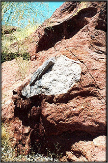 Granite boulder in sandstone on Camelback Mountain<br /> (note one foot long scale), in Phoenix, Arizona.