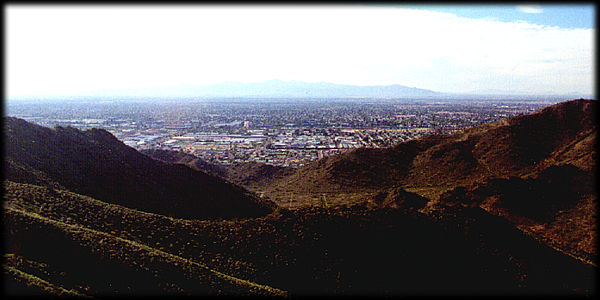 Looking directly west from North Mountain towards the Sun City area and the White Tank Mountains in the distance.